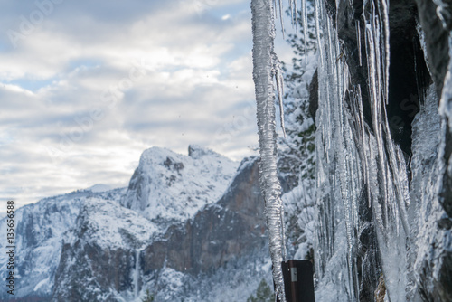 Poster Icicles hanging from the tunnel with a view Yosemite Valley