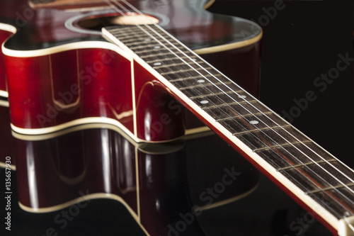 Acoustic guitar on black background Poster