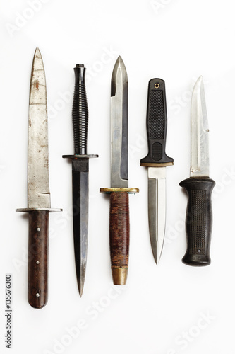 Selection of used combat and fighting knives Poster