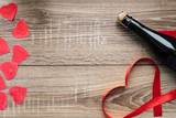 Gift , the heart and the bottle of red wine for a romantic holiday Valentines day