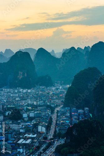 The view at the dawn of the cityscape and karst rock mountains in Yangshuo, Guilin region, Guangxi Province, China.