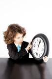 Little curly manager in a business suit sadly looks at his watch. The clock shows noon. White background.