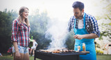 Happy outgoing people enjoying bbq