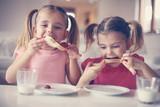 Girls eating breakfast.