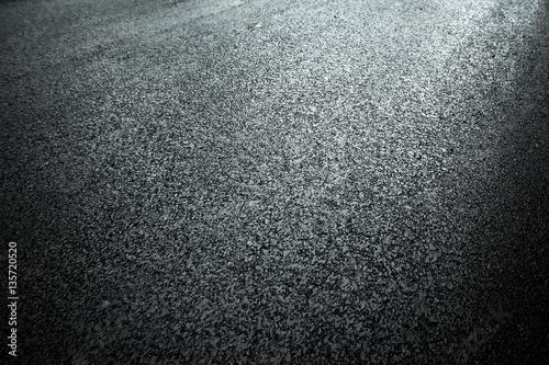 Dark asphalt roadbed.