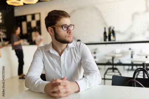 Businessman wearing shirt in cafe