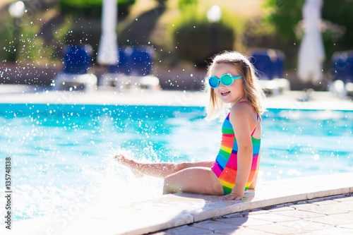 Poster Child in swimming pool on summer vacation