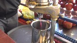 Man Pushes Pomegranate Juice