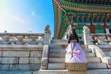 Korean Girls dressed Hanbok in traditional dress in Gyeongbokgung Palace, Seoul, South Korea