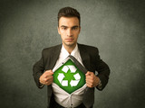 Enviromentalist business man tearing off shirt with recycle sign