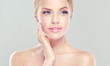 Постер, плакат: Beautiful Young Woman with clean fresh skin Facial treatment Cosmetology beauty and spa