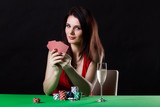 Very beautiful woman playing texas holdem poker
