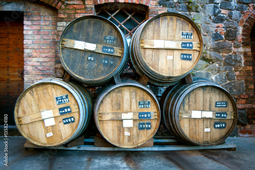 Five vintage wooden wine storage barrels stacked © hollandog
