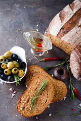Fresh bread with olive oil and olives