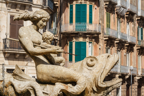 Old fountain in the historic centre of Syracuse, Sicily island,