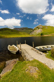 Llyn y Dywarchen Reservoir with two rowing boats by jetty, Snowd