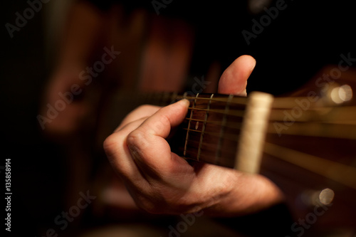 Close-up of men playing acoustic guitar Poster