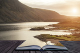 Beautiful sunset landscape image of Wast Water and mountains in