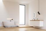 Corner of a white walls bathroom