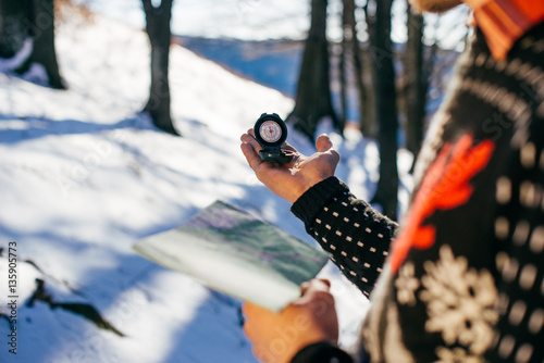 The tourist holds a map and compass