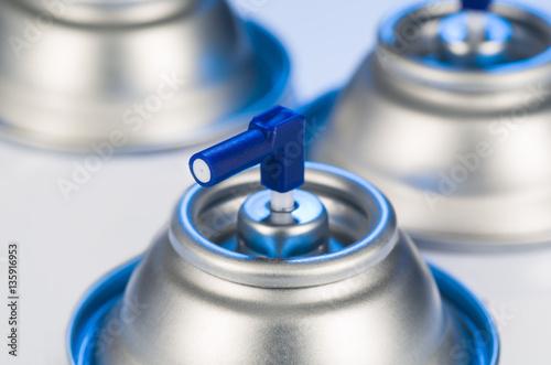 Aerosol spray cans nozzle closeup Poster