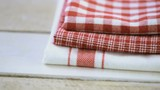 Dish towel on a wood background