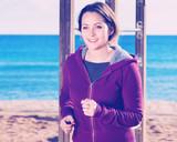 Young woman jogging at sea beach