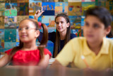 Smart Girl Raising Hand And Asking Question At School