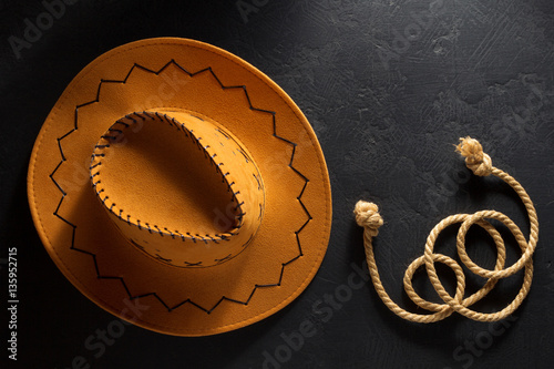 cowboy hat on wooden background. Plakát
