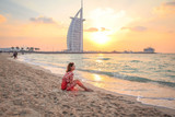 Woman Sitting On The Beach At Sunset 1