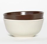set of brown and white ceramic bowls isolated on white background