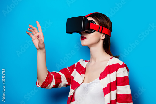 Poster woman with virtual reality gadget