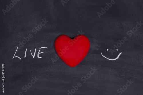 live love laugh concept on chalk board with red heart shape