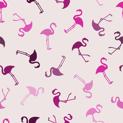Flamingo seamless pattern in pink and purple colors. Vector background design with flamingos for wallpaper, fabric, textile.