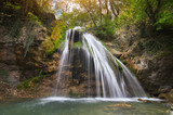 Spring waterfall and. Nature composition.