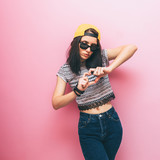 Fototapety Girl shows heart by fingers in fashion clothing