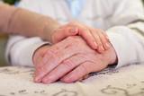 Elderly hands  young carers hands