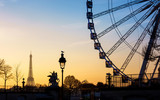 The ferris wheel and the Eiffel Tower in Paris - 136009582
