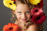 Portrait of a little girl with gerbera daisy