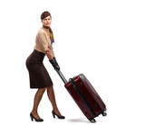young smiling stewardess with suitcase isolated on white background