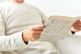 close up of senior man reading newspaper