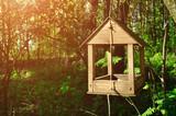 Wooden handmade bird feeder in form of little house