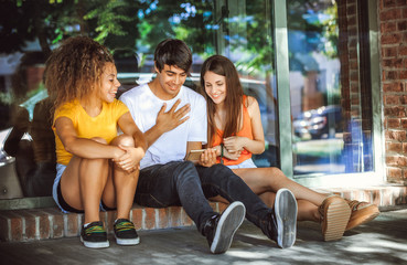 group of teenagers on the street with CellPhones