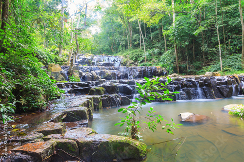 Beatiful of waterfall in national green forest background © Akarapong Suppasarn