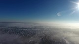 Flying over the beautiful village Bad Aussee, covered in fresh snow, Austrian Alps Panorama