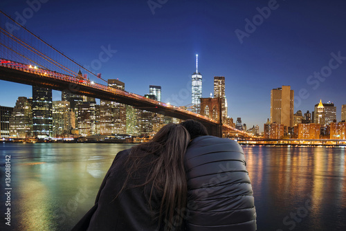 Aluminium New York girl and boy hugging each other in front of the new york city at night