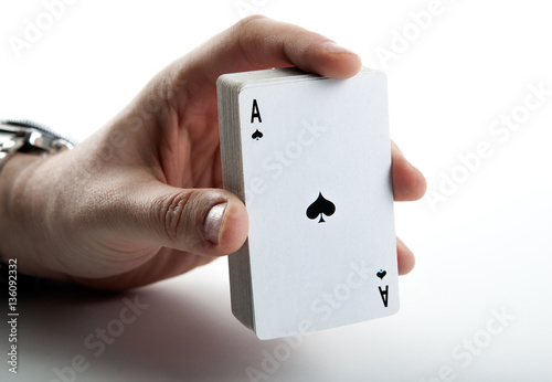 Plakat Human hand holding the ace of spades and a deck of cards