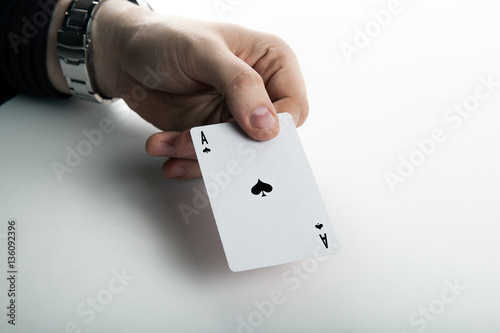 Poster Human hand holding the ace of spades