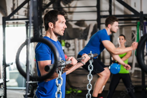 Man lifting dumbbell in functional training gym session