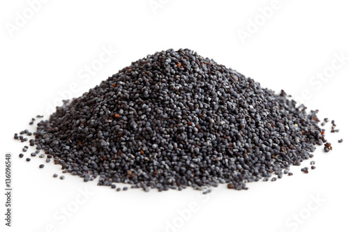 Heap of dry poppy seeds isolated on white.
